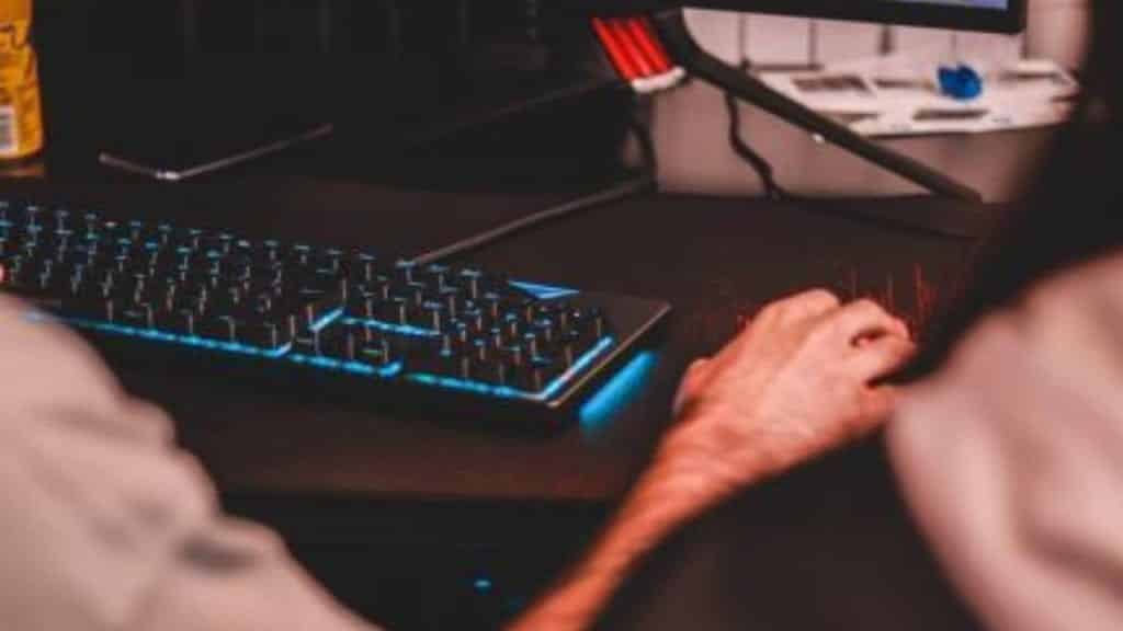 man using mouse and keyboard