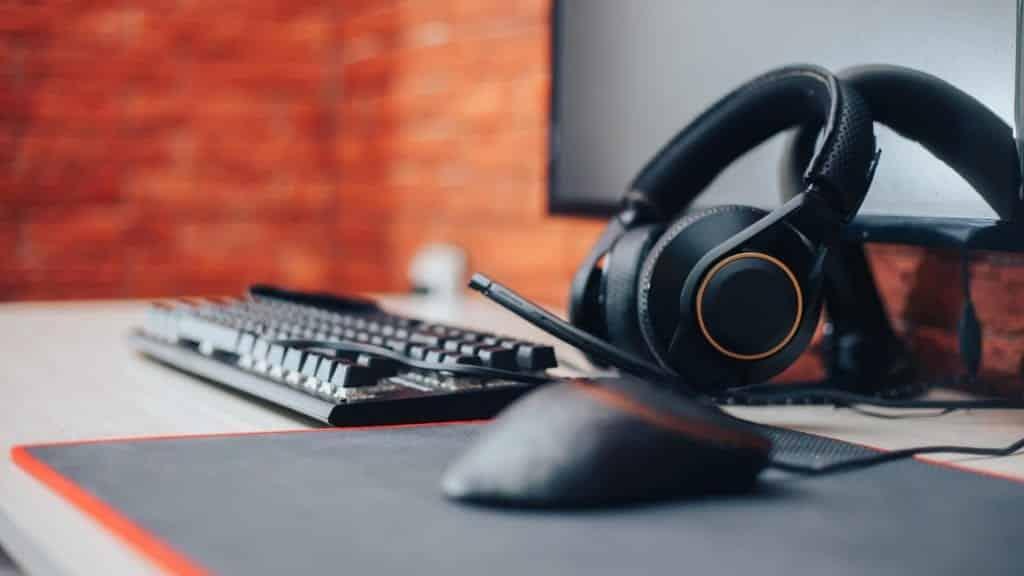 orange headset keyboard monitor