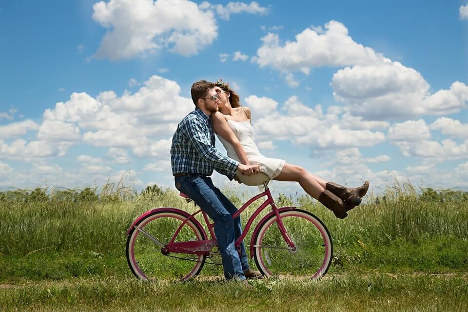 girl on boy's bike