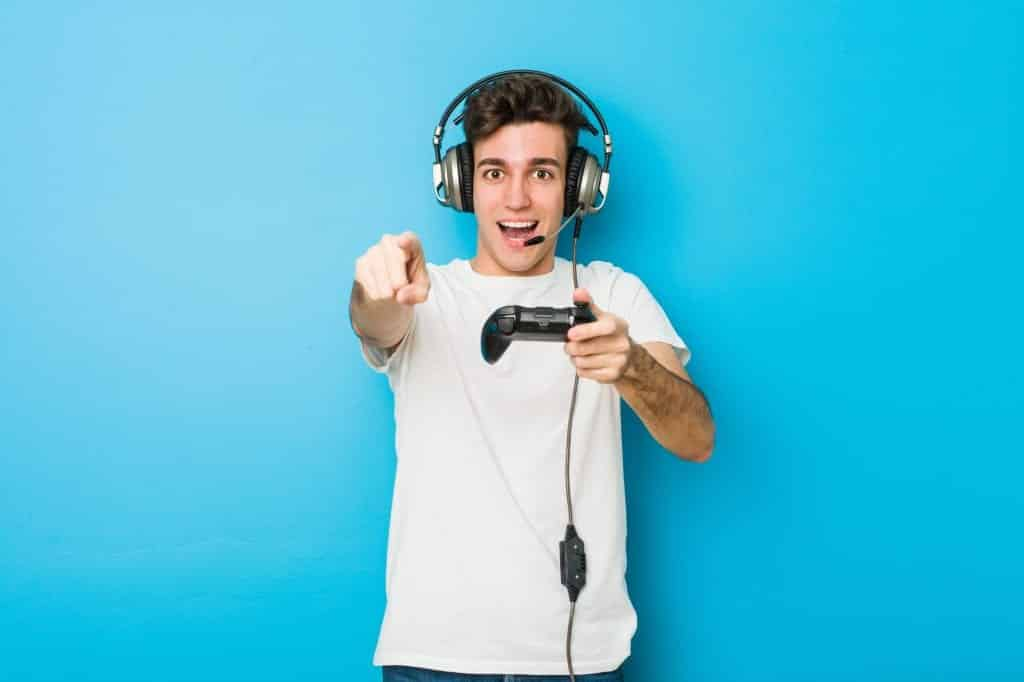 gamer in front of blue screen