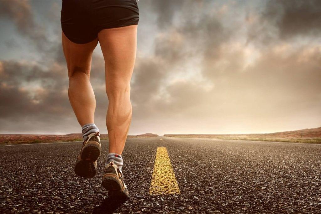 man jogging on road
