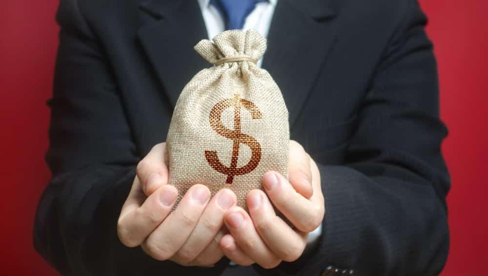 man holding a bag of cash